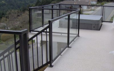 Deck with inset hot tub featuring glass panel Railcraft railings.