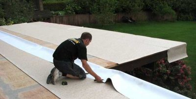 Duradek vinyl deck membrane being installed by an industry professional.